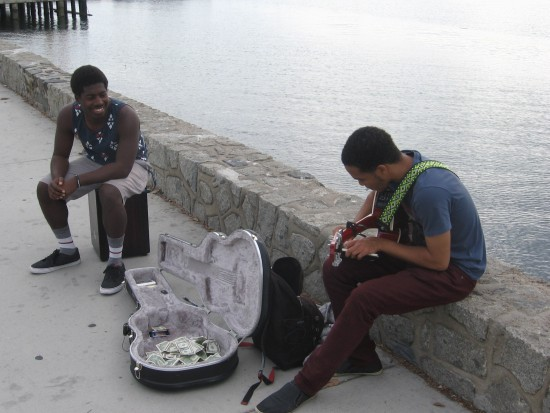 Joshua Randle and friend play music on San Diego's embarcadero.