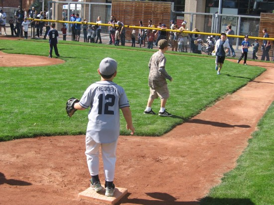 Kids enjoy small baseball field during Padres Fanfest.