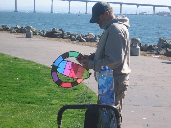 Man prepares small kite at Embarcadero Marina Park North.