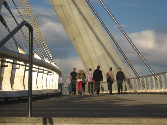 People cross the beautiful Harbor Drive bridge.
