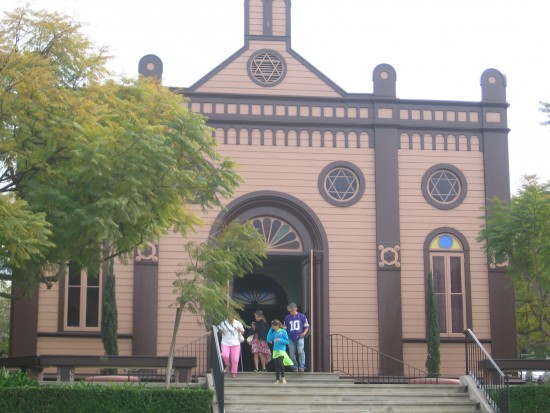 People emerge from San Diego's first synagogue, Temple Beth Israel.