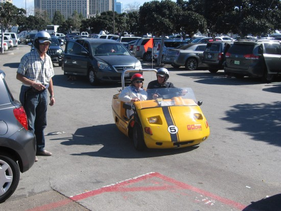 People in a tiny Go Car enjoy a GPS tour of San Diego.