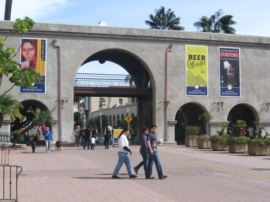 People walk through plaza in front of the Museum of Man.