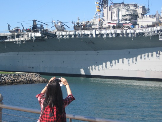 Photo being taken of USS Midway aircraft carrier.