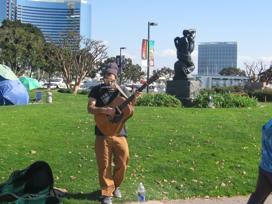 Playing a bluesy guitar near Seaport Village.
