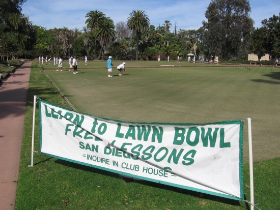Sign provides info about free lawn bowl lessons.