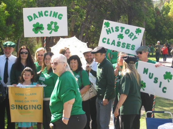 St. Patrick's Day Parade participants with signs.