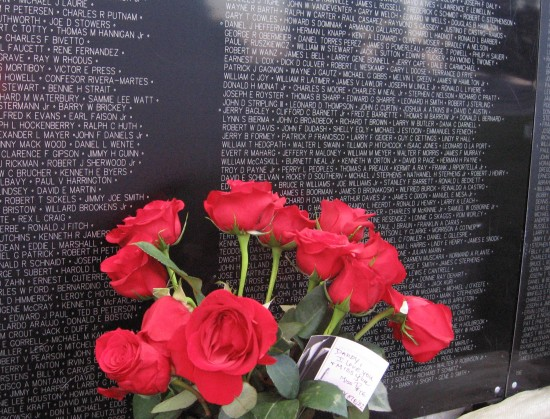 Flowers and the names of over 58,000 who gave their lives.