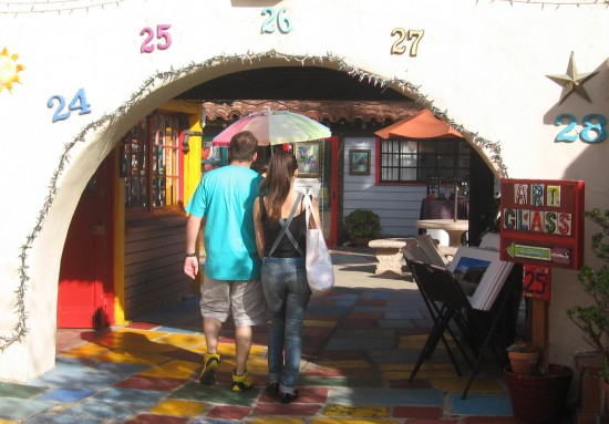 Couple explores folksy studios of Spanish Village.