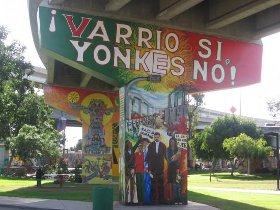 Barrio yes, junkyards no.