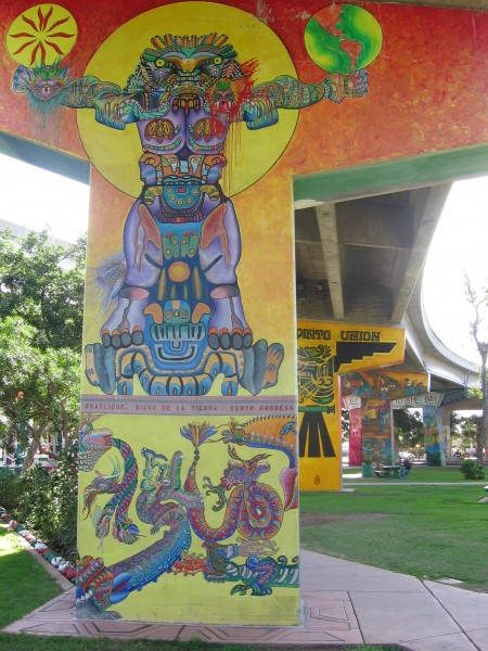 Elaborate Aztec figure painted on concrete pillar.