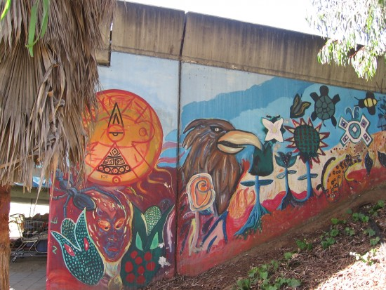 Various colorful images on a wall in Barrio Logan.
