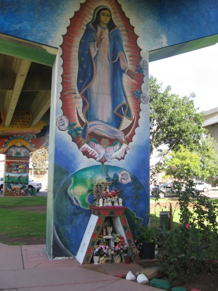 Virgin Mary and shrine at foot of Chicano Park mural.