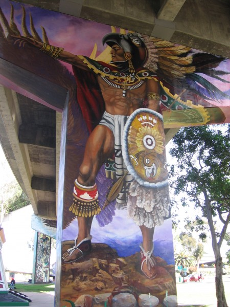 Aztec warrior and shield stand guard in San Diego.