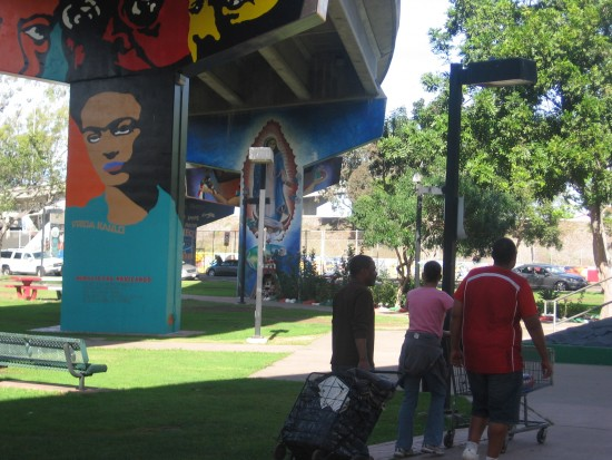 People walking through Chicano Park.