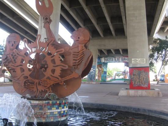 Fantastic metal sculpture in tiled fountain.