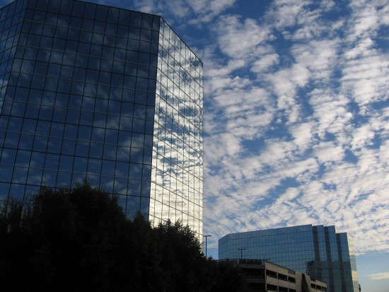 Clouds and reflections on two office buildings.