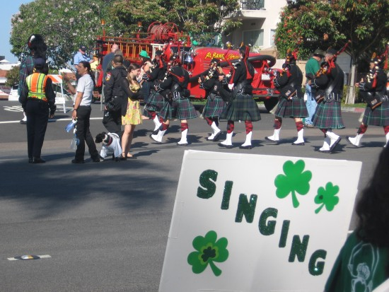 Bagpipers in kilts assemble for the parade near Balboa Park.