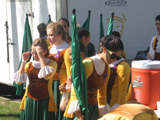 Girls anticipate marching on a sunny Saturday morning.