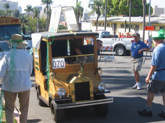 A funny little wooden vehicle in line to start the parade.
