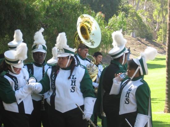 Lincoln High School band members in green.