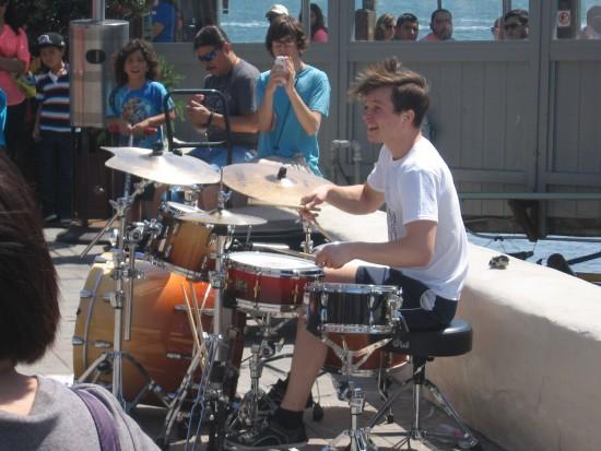 Baard Kolstad drums like crazy near the Pier Cafe.