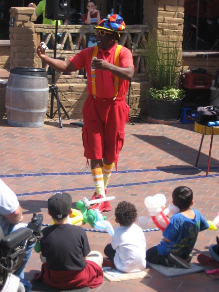 Funny magician wows kids at Seaport Village.