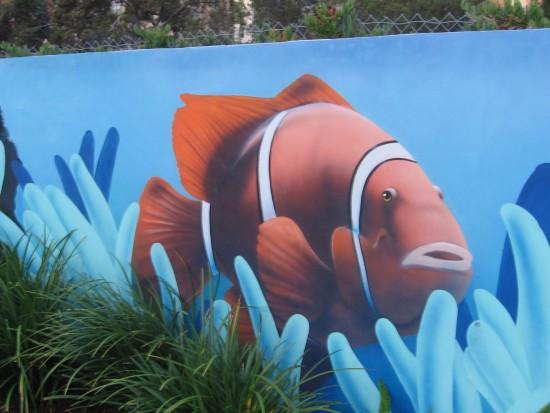 A bright orange fish swims through the city.
