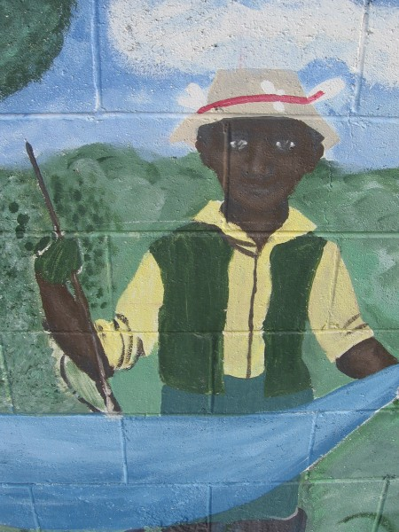 A figure from the extensive Our River mural.