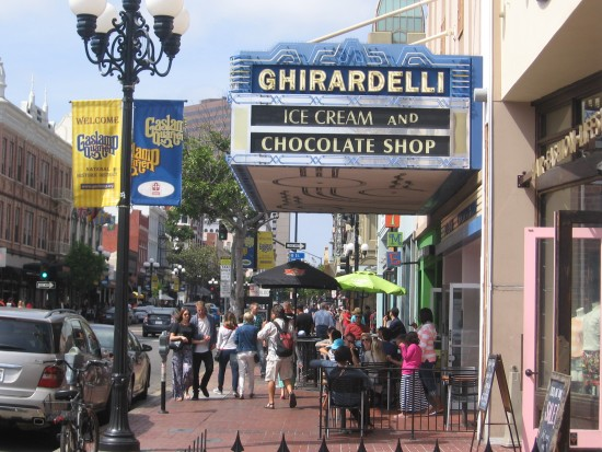 People stop to enjoy a treat at Ghirardelli's.