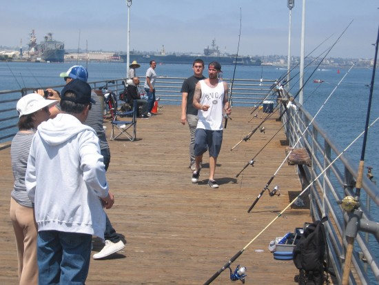 Fishing from the small Coronado Ferry Landing pier.
