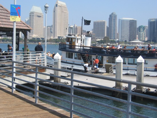 Silvergate docked at Coronado with San Diego skyline.