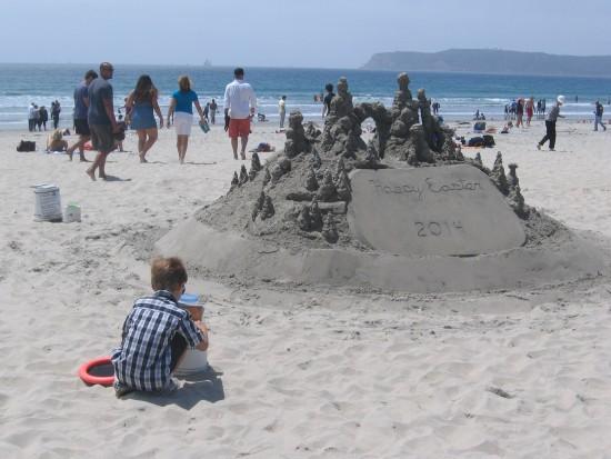 Boy plays on beach near the Hotel del Coronado.