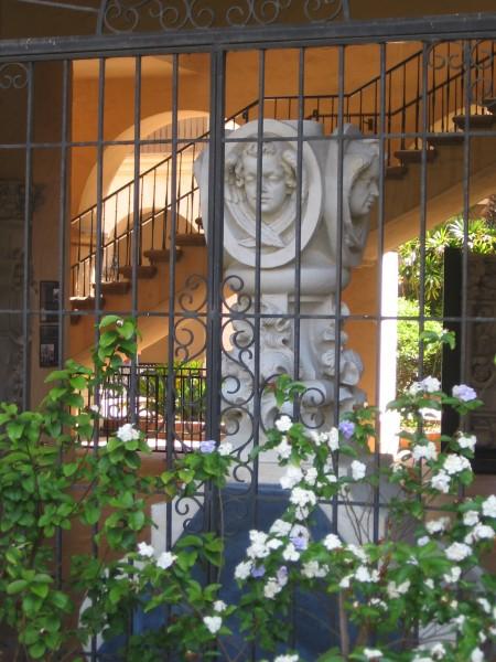 Plaster column seen through arch of Casa del Prado.