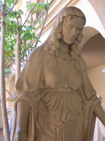 Freestanding figure of a woman in flowing robes titled Religion.  It stood atop the 1914 retablo of the Varied Industries Building.