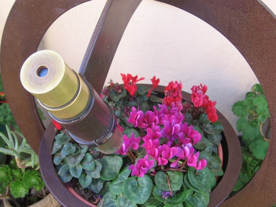 A kaleidoscope aimed at turning bowl of flowers.