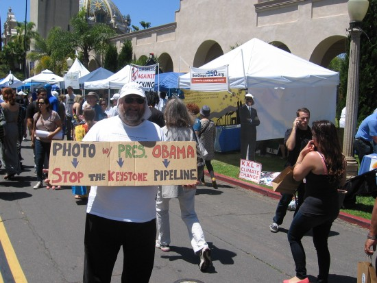 Activist at EarthFair fights the Keystone Pipeline.