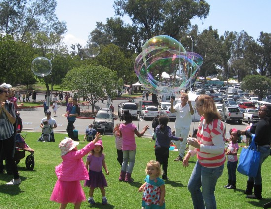 Kids have fun with great big bubbles.