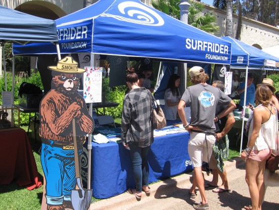 Smokey the Bear stands near Surfrider Foundation booth.