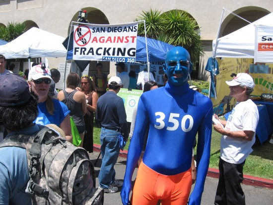 Man painted blue advocates for lower carbon emissions.