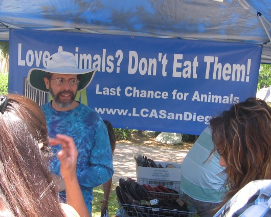 Banner in booth opposes eating animals.