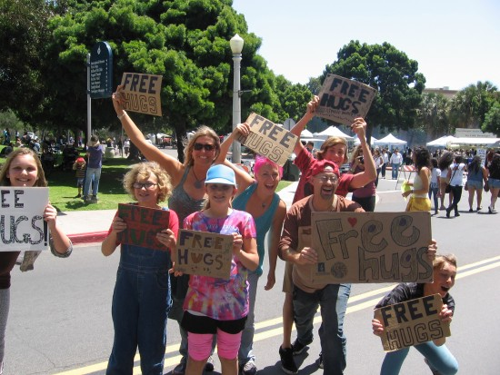 Free hugs are offered to visitors of Balboa Park's EarthFair!