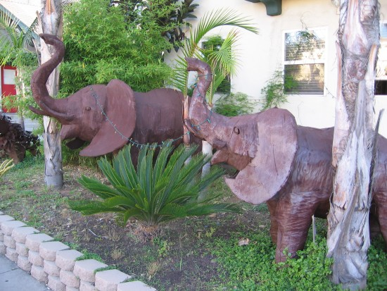 Two metal sculpture elephants on First Avenue.