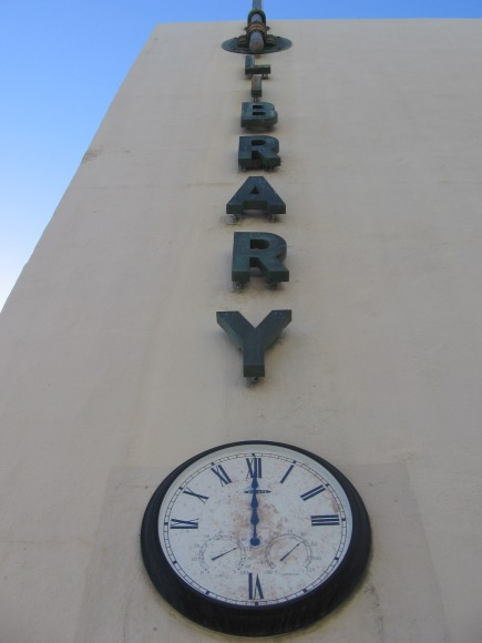 Clock shows midnight on closed San Diego library.