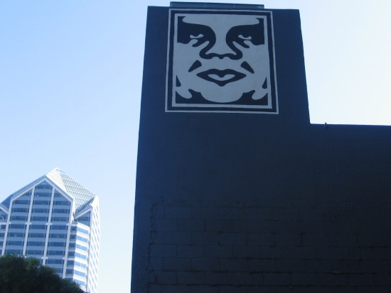 Face of Andre the Giant high on a building near America Plaza.
