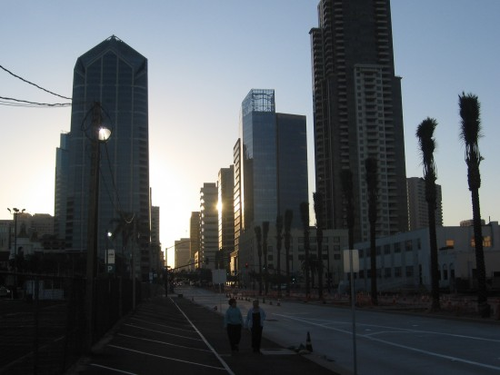 Sunrise touches downtown San Diego skyscrapers with light.
