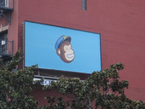 Grinning monkey head on billboard in San Diego.