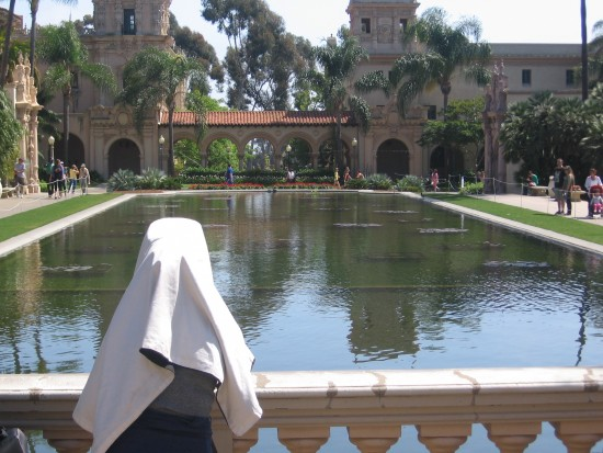 Photographer at work beside Balboa Park's reflecting pool.