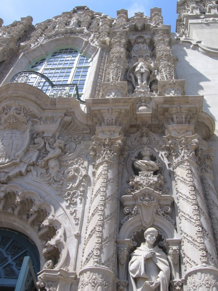 Plaster figures from local history adorn the ornate facade.