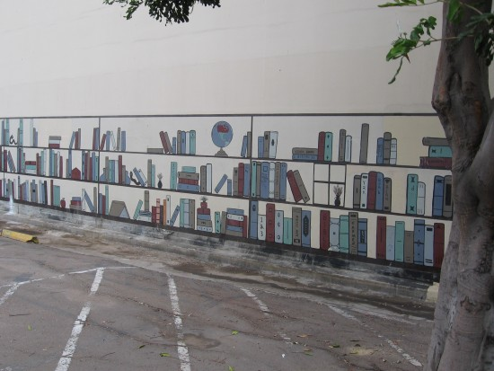 Books still line the parking lot behind vacant library.